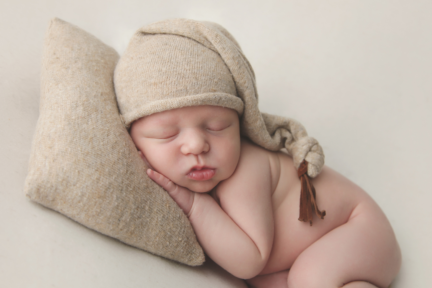 Fort Worth Newborn Photographer sleepy hat pillow