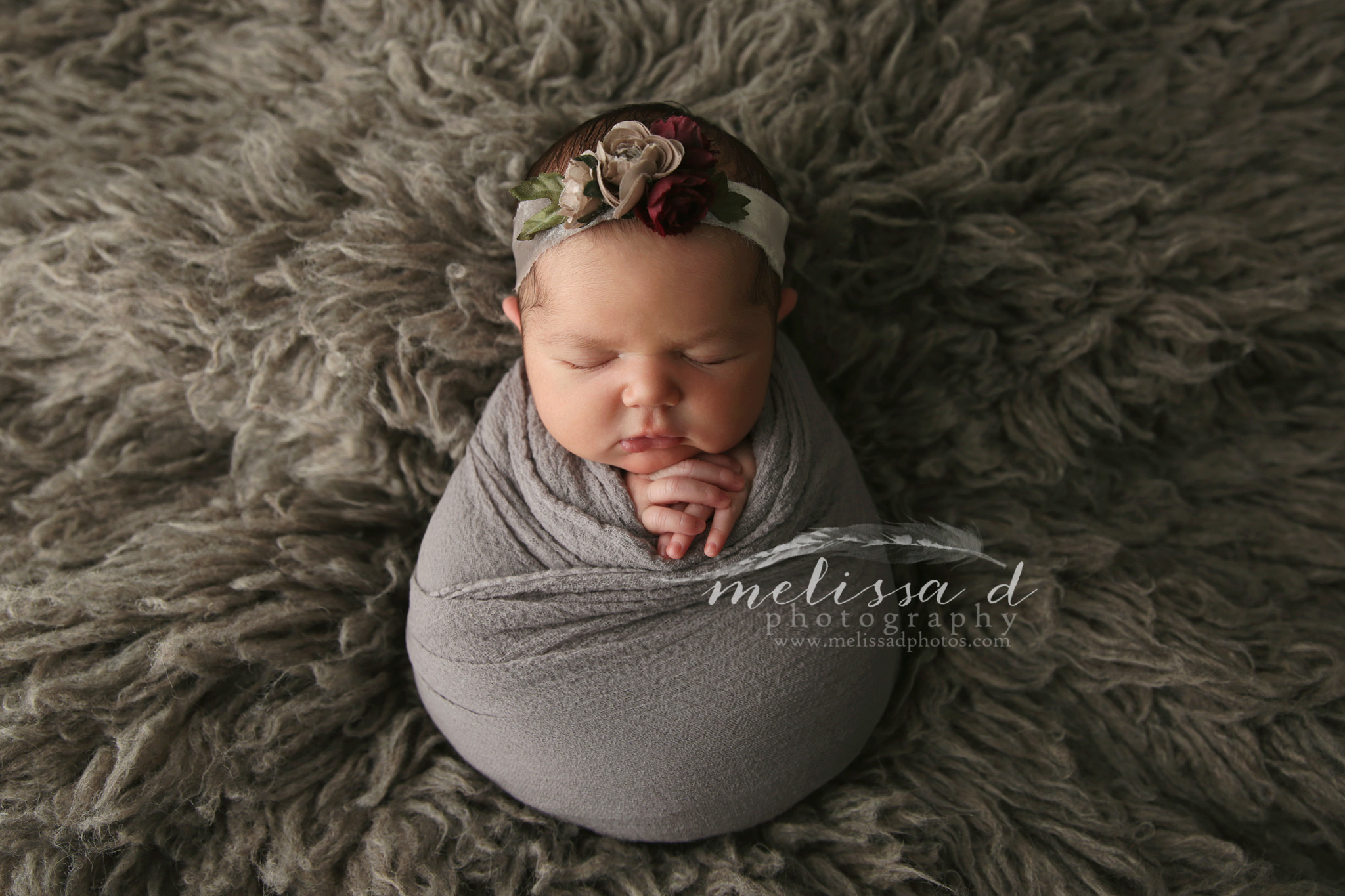 Ft. Worth Newborn Photographer fur wrapped pose